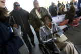 DM0266   A volunteer directs Bertha Phillips, 96, in wheelchair, Ida Mims, 65, behind, and Johnny ...