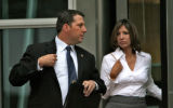 Cory Voorhis, right, leaves the Alfred A. Arraj United States Courthouse, with his wife Paula...