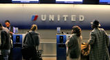Passengers at the United ticket counter  at Denver International Airport   early Wednesday morning...