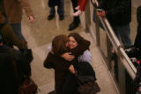 DM0066   Hayley Mathers, 26, gives her mom Pam Mangum of Atlanta, Georgia a big hug upon arrival...