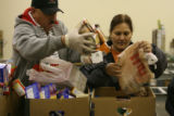 Food Bank of the Rockies volunteers, Jose Sanchez and Maria Esponoza, sort out collected food...