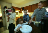 Aubrey Stacy (cq) stirs the crust as son, Elias Stacy, 9 and Elizabeth Smith 4  help with sister...