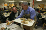 Gov. Ritter serves a Thanksgiving lunch to Karl Mau, cq, Wednesday Nov. 21, 2007 at the Denver...