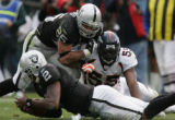 [JOE197]  Oakland Raiders Justin Fargas (25) blocks Denver Broncos D.J. Williams as Williams...