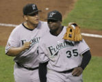 NY179 - ** FILE ** Florida Marlins starting pitcher Dontrelle Willis (35) is congratulated by...