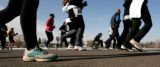 Runners past the south lake in Wash Park as they join in the Mile High United Way 34th Annual...