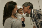 Paul Sandoval (cq) gives his granddaughter Ariel a kiss while his daughter Andrea Sandoval watches...