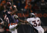 Denver Bronco cornerback Dre Bly is called for illegal contact while defending Chicago Bear's wide...