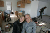 [JOE0019]  Kristina, left, and Dave Yarrington (both cq) sit amid construction material as work...