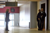 New Life Church by a security guard, Jeanne Assam, 42, left, walks down the hallway of the east...