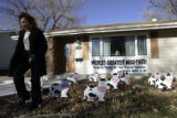 Karen Goodson put up a 22 cow installation into her mother Rita Higgins' front yard Nov. 27, 2007,...