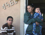 CODER101 - Mareaneta Banuelos (cq) stands on her porchTuesday November 27,2007  with sons Hever...