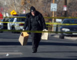 CODER102 - Denver Police remove evidence from  the scene of a deadly shooting which happened an...