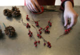 6.  How to make a wreath with Denise Capelli at Capelli Floral:  Add berries and pine cones as...