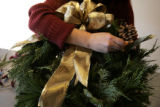 9. How to make a wreath with Denise Capelli at Capelli Floral:  Continue to add accents.  (JUDY...
