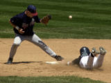 (LAKEWOOD, Colo., May 21, 2004)  Northridge's Erik Hogstad can't hold onto a bouncer as Niwot's...
