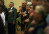 MJM026 Governor Bill Ritter takes part in the pledge of allegiance as he waits to address...