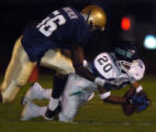 (9/24/2004) Denver, Colorado-Overland's Marquis Cox (20) tries to recover a fumble while being...