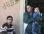 Mareaneta Banuelos (cq) stands on her porchTuesday November 27,2007  with sons Hever Ruiz (cq),...