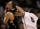 0256 University of Denver #5 Tyler Bullock elbows University of Colorado #23 Richard Roby in the...