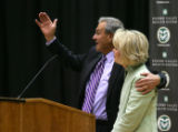 Head Coach Sonny Lubick talks with his arm around his wife Carol Jo Lubick at a press conference...