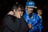 DM0255   Roberta Dominguez walks away in tears and is comforted by her husband Robert Dominguez as...