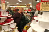 Mary Ann Craft (cq) looks around while standing in the check-out line at Kohl's in Littleton...