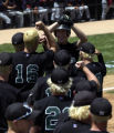 (LAKEWOOD, Colo., May 21, 2004)  Niwot's pitcher, Sean Ratliff (6), celebrates with his team-mates...