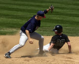 (LAKEWOOD, Colo., May 21, 2004)  Niwot's Nick Stockwell (28) steals 2nd base in the 5th inning...