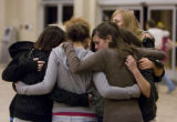 DM0186   A group of teens huddles in prayer inside New Life Church in Colorado Springs, Colo....