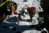 0073 A woman who wished to remain anonymous brought a bouquet of roses to lay in front of the...