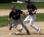 (LAKEWOOD, Colo., May 21, 2004)  Niwot's Kevin Gzym (9) is safe at third due to a wild throw past...