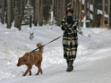 Jane Barber (cq) walks her dog, Molly, on Country Road, Wednesday morning, November 28, 2007,...