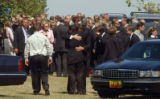 (BEATRICE, Nebraska, September10, 2004) Hugs of emotion after the cemetery services were complete....