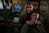 CEO Denise Sutton and husband John Sutton run Warpradio and pose in the studio for their radio...