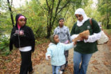 (NYT81) MINNEAPOLIS, Minn. -- Nov. 27, 2007 -- MUSLIMS-GIRL-SCOUTS-4 -- Troop leader Farheen...