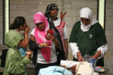 (NYT78) MINNEAPOLIS, Minn. -- Nov. 27, 2007 -- MUSLIMS-GIRL-SCOUTS -- Troop leader Farheen Hakeem,...