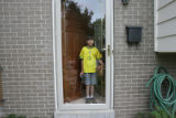 Danny Hoffenberg, 10, (cq) has had two heart transplants. He plays for portraits in his doorway...