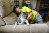 Danny Hoffenberg, 10, (cq) has had two heart transplants. He plays with an uninterested pet cat...