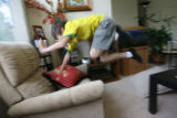 Danny Hoffenberg, 10, (cq) has had two heart transplants. He jumps from the table to the chair, as...