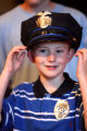 Cancer patient Travis Mickelsen (cq), age 8, tries on his new police hat after being  sworn in as...