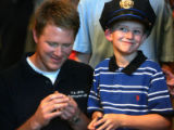 L to R: Brett Mickelsen (cq) admires his son's badge after Cancer patient Travis Mickelsen (cq),...