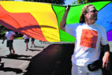 DLM0335  Jim Halpenny, 42, of Denver carries a giant rainbow flag along with the other members of...