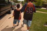 (LAKEWOOD, Colo., May 20, 2004) The two head to the park to launch their rocket...  Larry and...