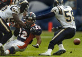 (Denver, Col, September 26, 2004)  Quentin Griffin fumbles the ball in the third quarter of the...