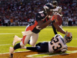(Denver, Col, September 26, 2004)  Ashley Lelie leaps into the end zone after catching a touchdown...