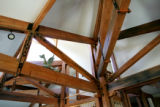 Beams, salvaged from a century-old bridge from the Great Salt Lake, branch out like a tree in the...