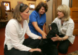 From left- Sunni Rodgers, of Denver, Veterinary Assistant Margaret Price, center, and Vet Susan...