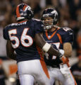 (Denver, Colo., on Sunday night, Sept. 12, 2004) Denver Broncos John Lynch, #47, celebrates with...