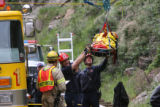 Emergency personal lower Topeka, Kansas resident Davis Seals, 34, to the ground Tuesday June 12,...